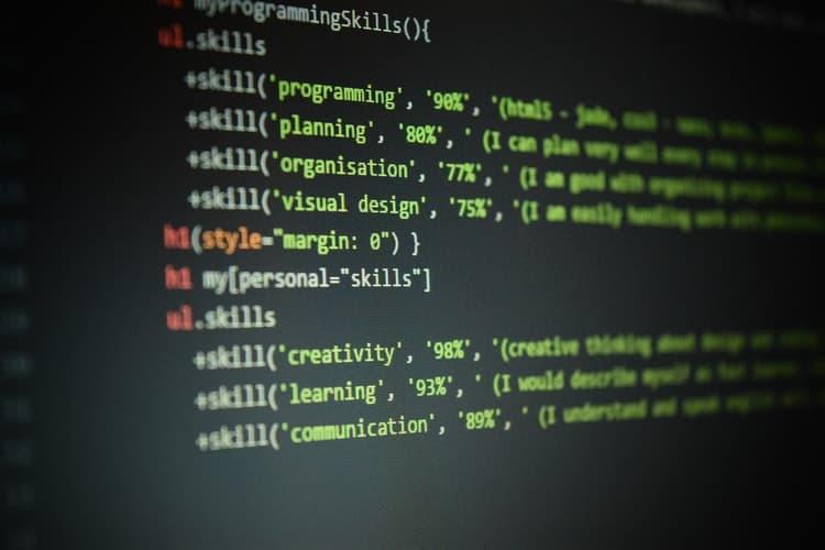 A black monitor displaying HTML code