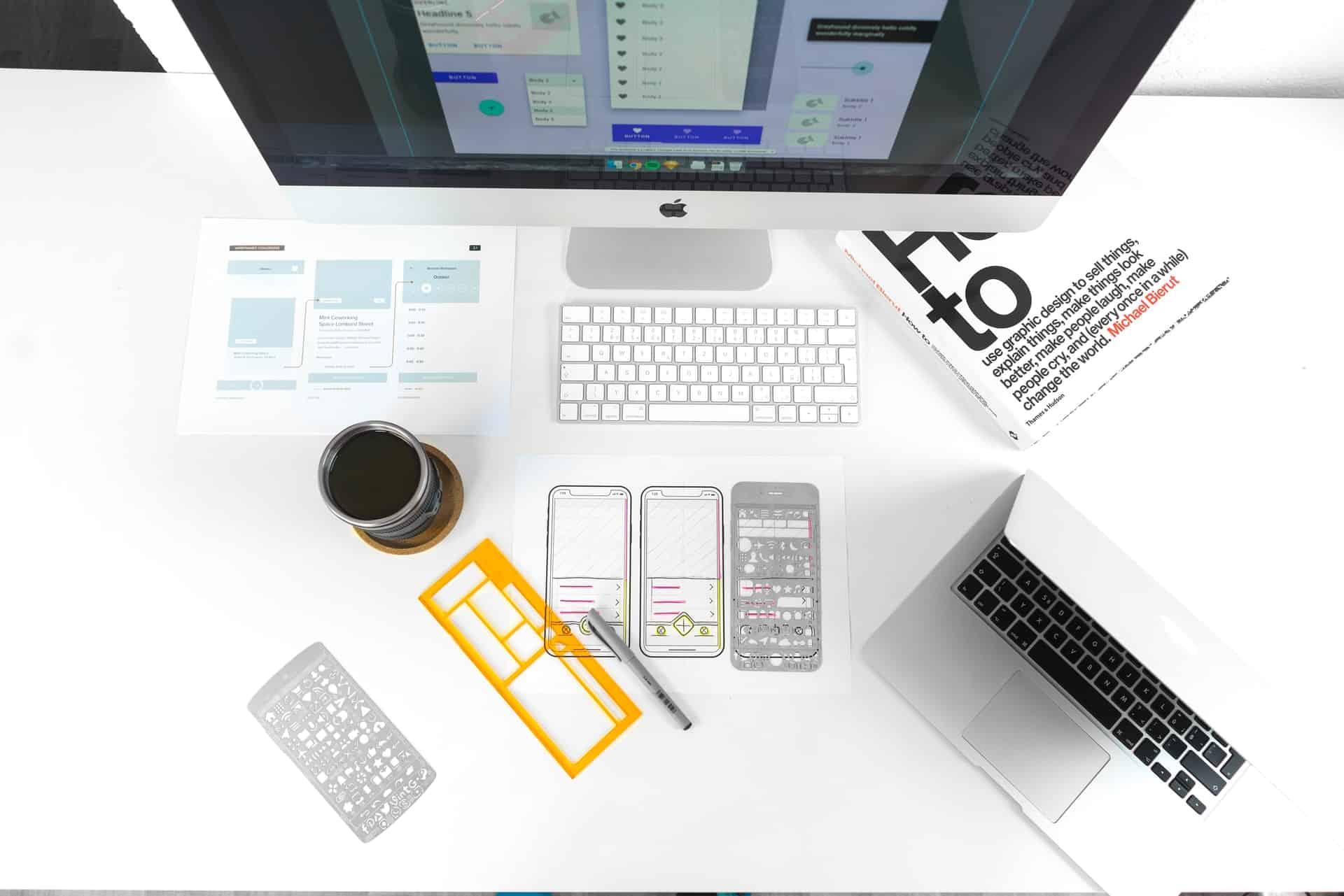 UX design tools on computer desk