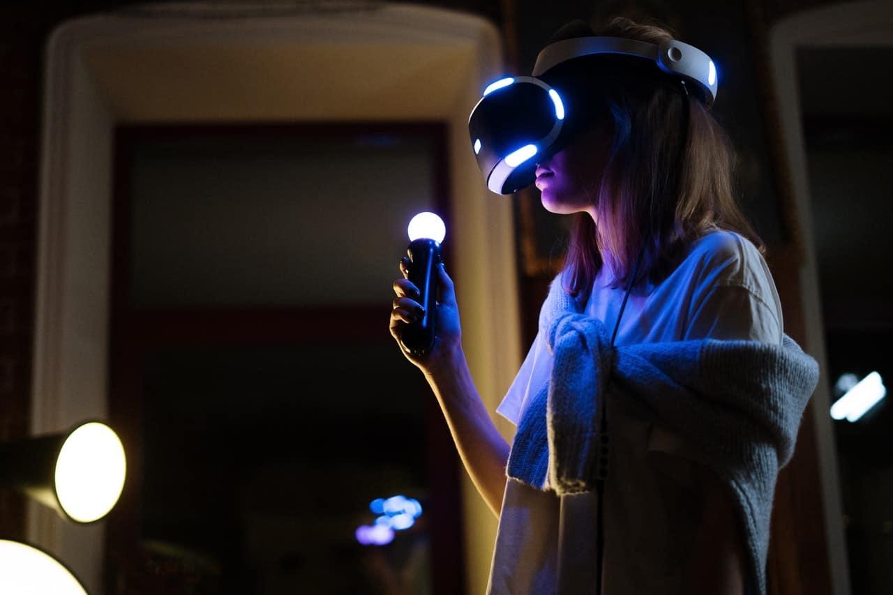 A woman uses a virtual reality headset