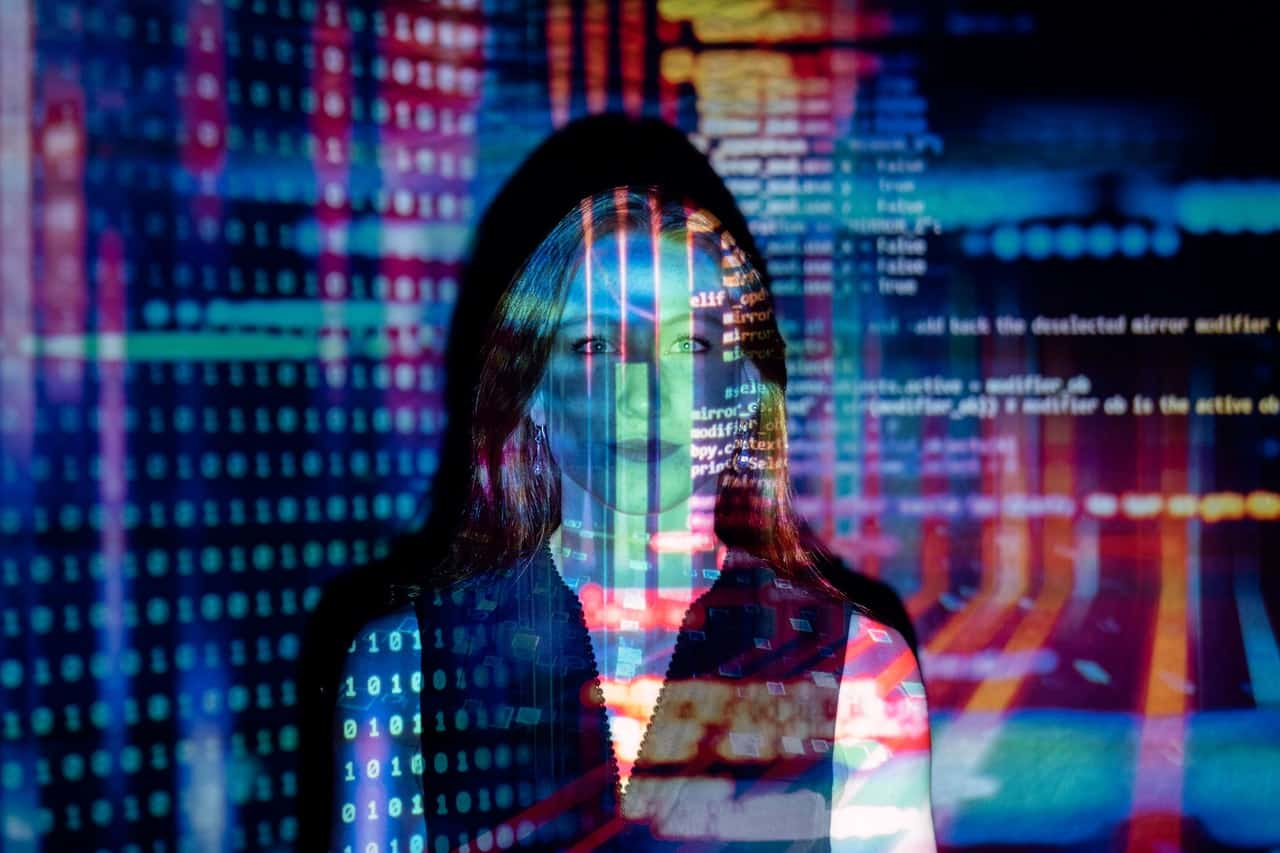 Code projected over woman in many colors
