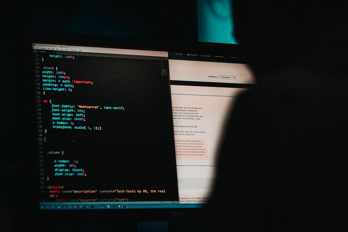 a person programming in html on computer
