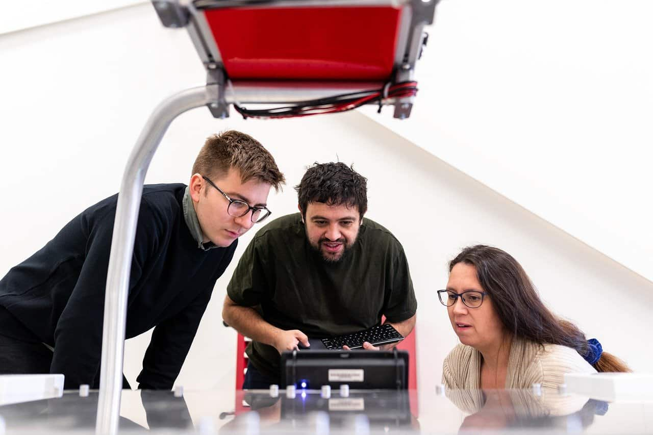 two men and a woman testing software