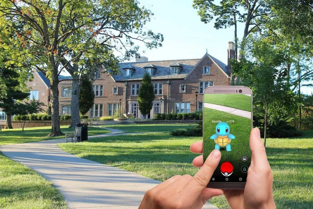 Gamer playing Pokémon Go in an upscale neighborhood How to Code a Game