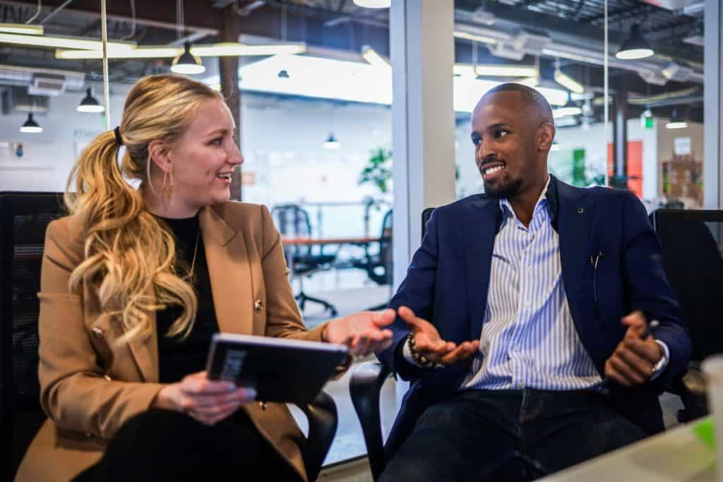 Woman interviewing man in office for coding job What Jobs Can You Do as a Coder?