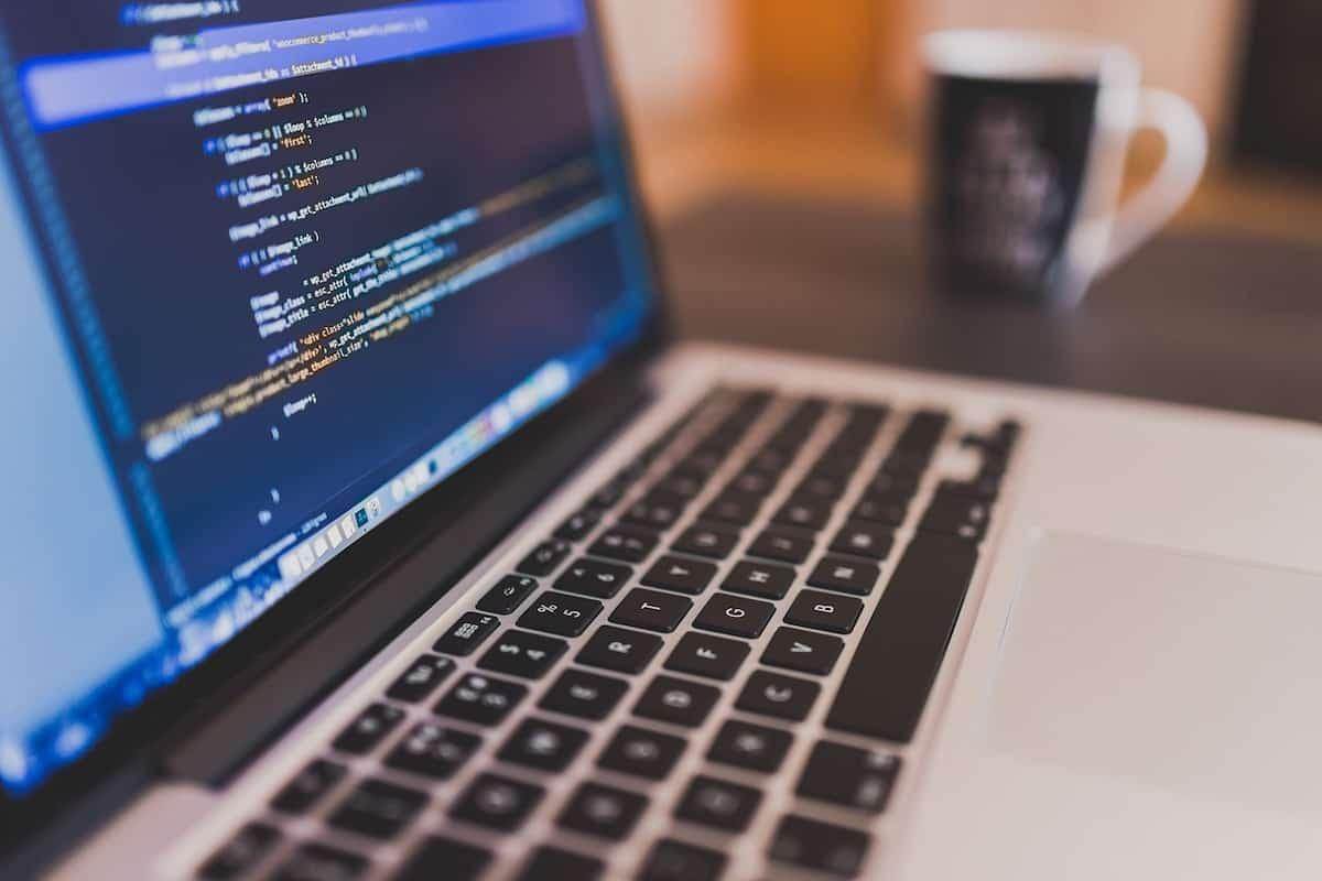 MacBook displaying code How to Get a Programming Job