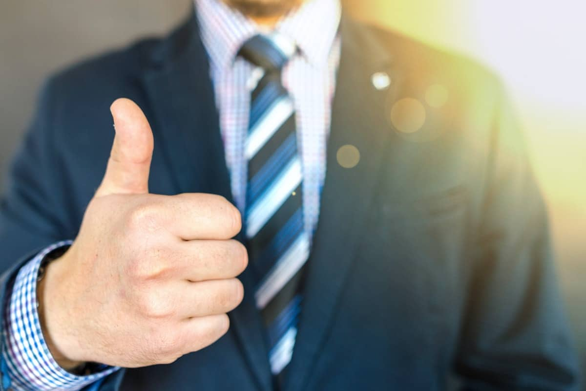 A man in a suit holding a thumbs up. How to Make a Career Change