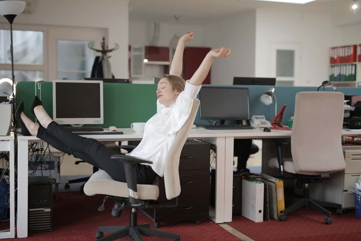 Tech worker relaxing with her feet on the desk. Is Technology a Good Career Path?