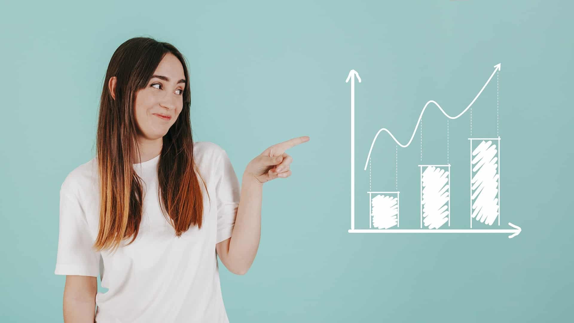Confident young woman with business analytics skills pointing at a graph Learn to Use Microsoft Excel Like a Data Analyst