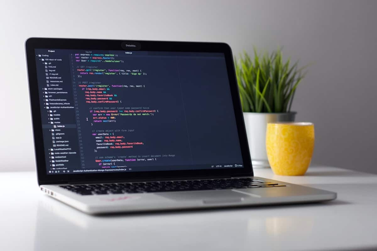 Desktop displaying coding process How to Code a Website: A Guide for Beginners in Web Design