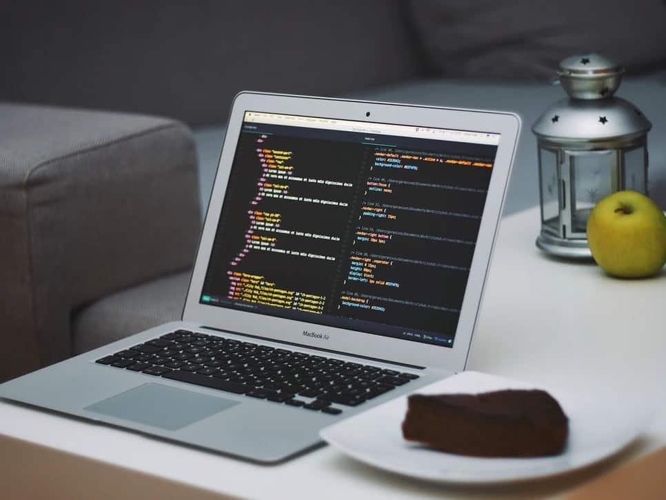 laptop displaying code next to a plated piece of chocolate cake  what is object oriented programming