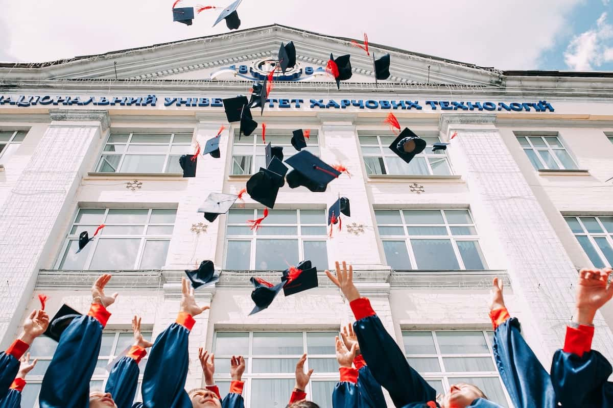 Campus graduates throwing their hats up is college for everyone