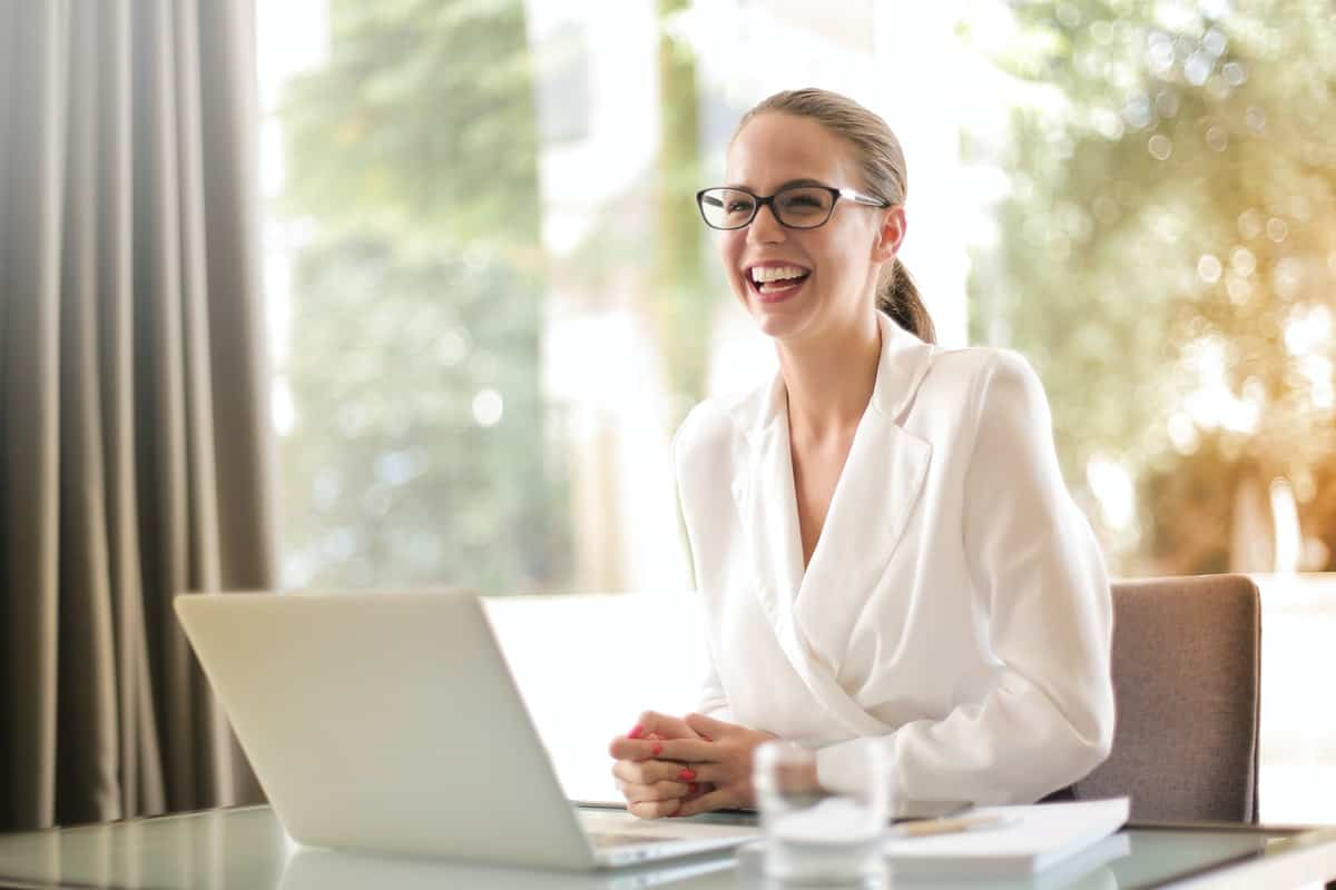 A woman smiling in her office as she works. Jobs for Career Change